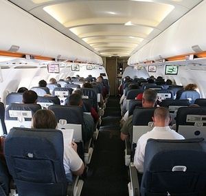 fly first class or business